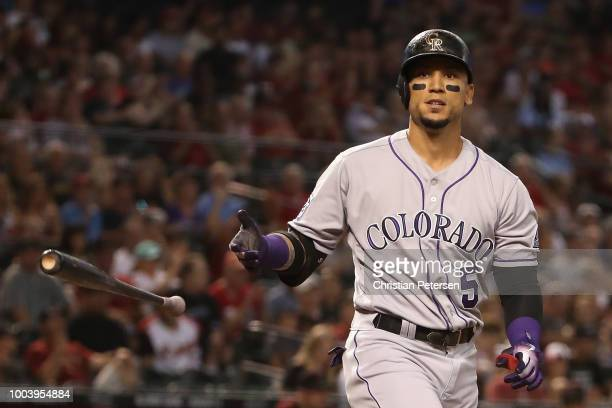 Outfielder David Peralta of the Arizona Diamondbacks walks to his position during the ninth inning of the MLB game against the Colorado Rockies at...
