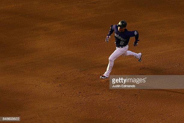 Carlos Gonzalez of the Colorado Rockies runs to third on his way to scoring during the fifth inning against the Philadelphia Phillies at Coors Field...