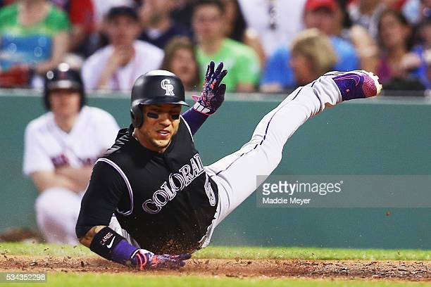 Carlos Gonzalez of the Colorado Rockies scores a run against the Boston Red Sox during the fourth inning at Fenway Park on May 25 2016 in Boston...