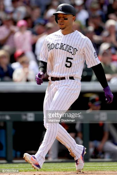 Carlos Gonzalez of the Colorado Rockies scores on a Trevor Story 2 RBI single in the sixth inning against the San Francisco Giants at Coors Field on...