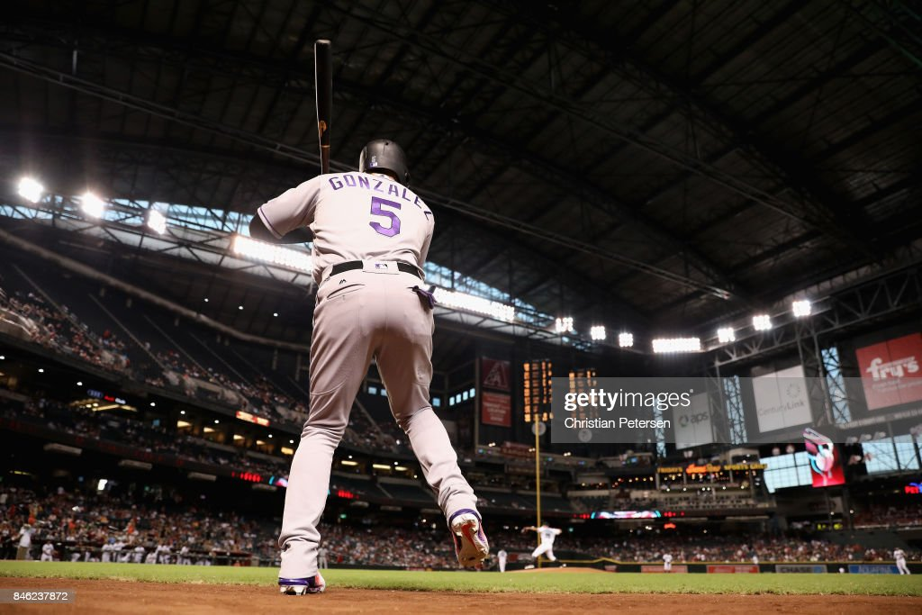 Carlos Gonzalez #5 of the Colorado Rockies warms up on deck during the first inning of the MLB game against the Arizona Diamondbacks at Chase Field on September 12, 2017 in Phoenix, Arizona.