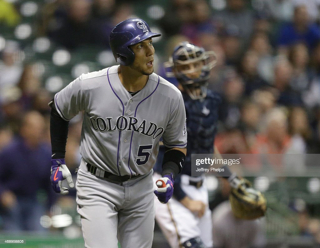 Carlos Gonzalez #5 of the Colorado Rockies watches his two-run home run against the Milwaukee Brewers in the eighth inning at Miller Park on April 8, 2015 in Milwaukee, Wisconsin.