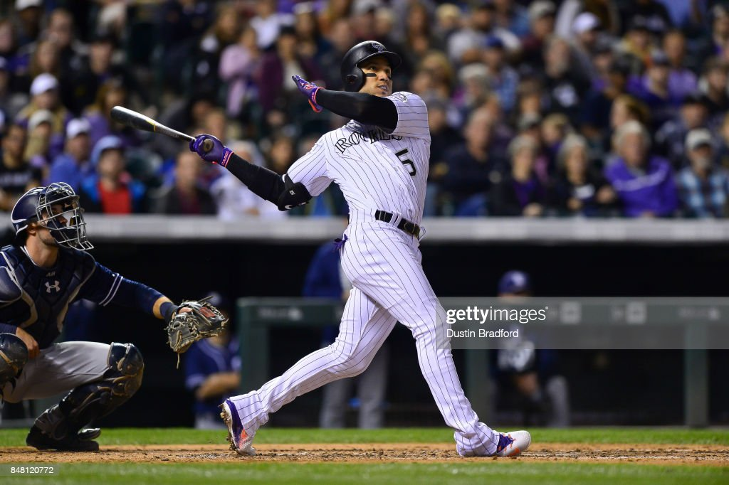 Carlos Gonzalez #5 of the Colorado Rockies watches the flight of a fifth inning two-run homerun against the San Diego Padres at Coors Field on September 16, 2017 in Denver, Colorado.