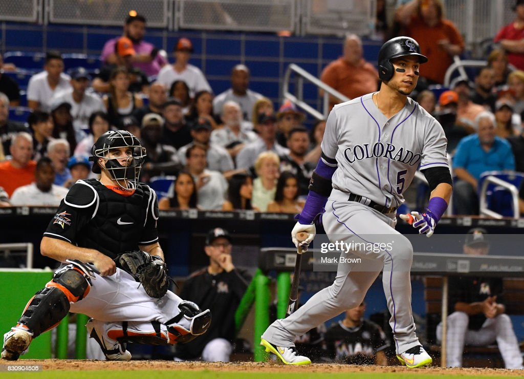 Carlos Gonzalez #5 of the Colorado Rockies with the RBI in the eighth inning during the game between the Miami Marlins and the Colorado Rockies at Marlins Park on August 12, 2017 in Miami, Florida.