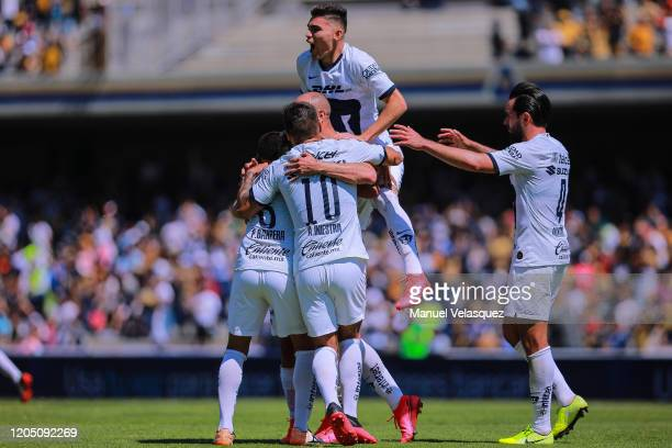 Carlos González of Pumas celebrates the second scored goal of Pumas with his teammates during the 5th round match between Pumas UNAM and Atletico San...