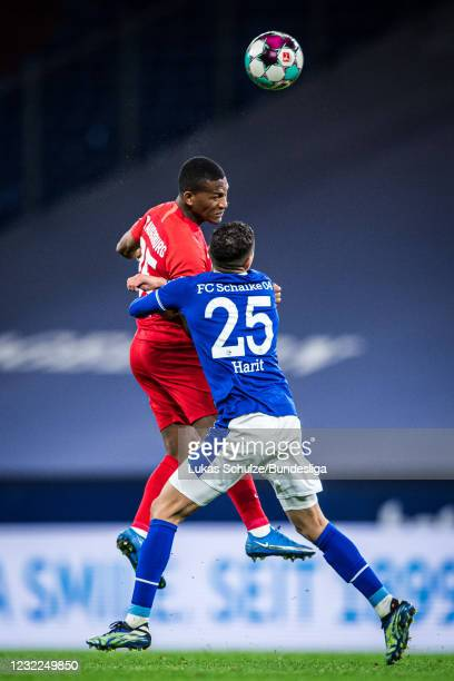 Carlos Gruezo of Augsburg and Amine Harit of Schalke in action during the Bundesliga match between FC Schalke 04 and FC Augsburg at Veltins-Arena on...