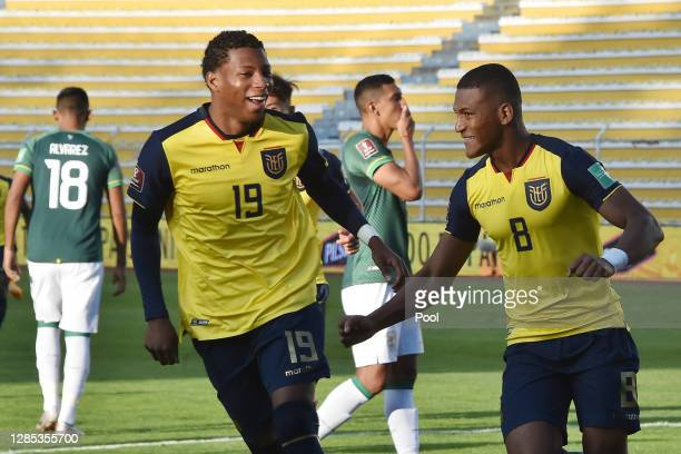 Carlos Gruezo of Ecuador celebrates with Gonzalo Plata of Ecuador after scoring the third goal of his teamduring a match between Bolivia and Ecuador...