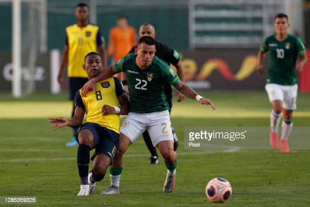 Carlos Gruezo of Ecuador fights for the ball with Henry Vaca of Bolivia during a match between Bolivia and Ecuador as part of South American...