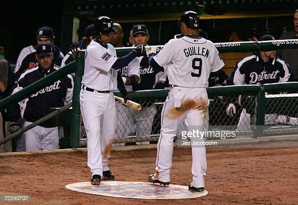 Carlos Guillen of the Detroit Tigers celebrates with Ramon Santiago after scoring in the fifth inning on an RBI single by Sean Casey against the St...