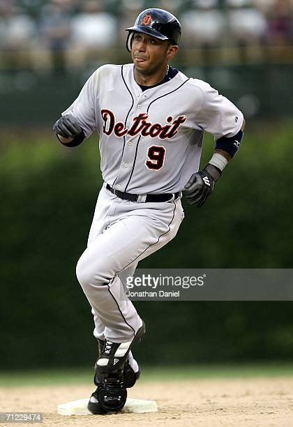 Carlos Guillen of the Detroit Tigers gets to second base after hitting a runscoring double in the 8th inning against the Chicago Cubs on June 17 2006...