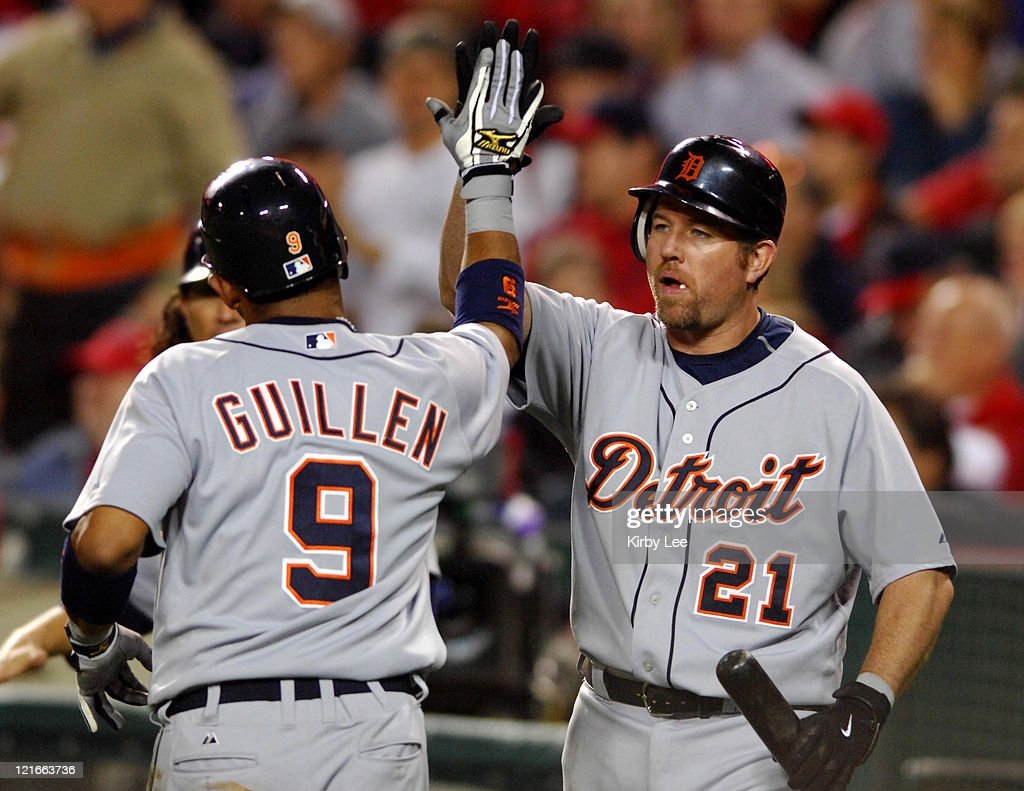 Carlos Guillen of the Detroit Tigers is congratulated by Sean Casey after scoring in the second inning of Major League Baseball game against the Los Angeles Angels of Anaheim at Angel Stadium in Anahiem, Calif. on Monday, April 23, 2007. The Tigers defeated the Angels, 9-5.