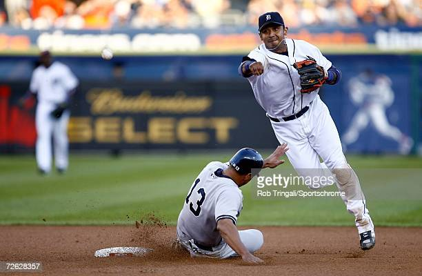 Carlos Guillen of the Detroit Tigers turns a double-play as Alex Rodriguez of the the New York Yankees slides during Game Four of the 2006 American...