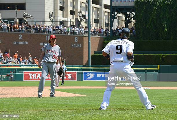Carlos Guillen of the Detroit Tigers watches as his 7th inning home run sails over the fence while Jered Weaver of the Los Angeles Angels of Anaheim...
