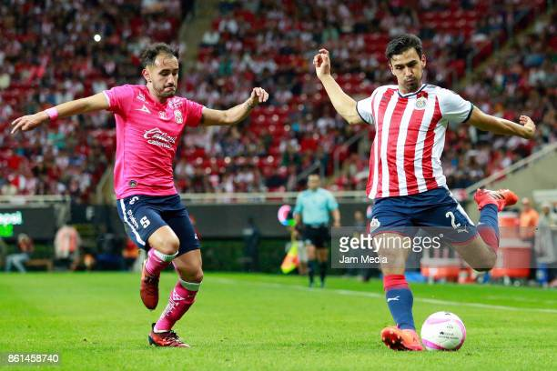 Carlos Guzman of Morelia and Oswaldo Alanis of Chivas fight for the ball during the 13th round match between Chivas and Morelia as part of the Torneo...