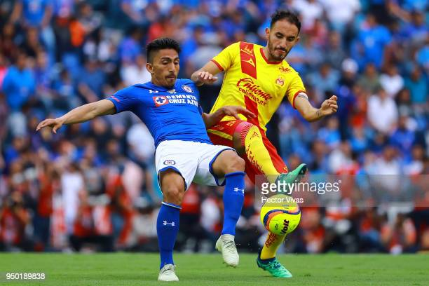Carlos Guzman of Morelia struggles for the ball with Angel Mena of Cruz Azul during the 16th round match between Cruz Azul and Morelia as part of the...