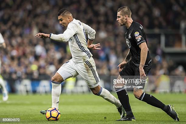 Carlos Henrique Casemiro of Real Madrid battles for the ball with Raul Albentosa Redal of RC Deportivo La Coruna during the La Liga match between...