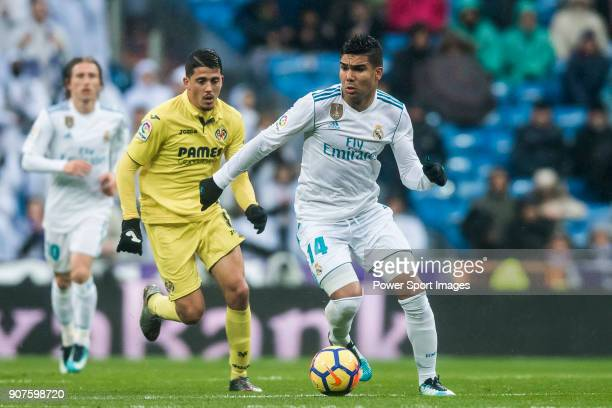 Carlos Henrique Casemiro of Real Madrid is followed by Pablo Fornals of Villarreal CF during the La Liga 201718 match between Real Madrid and...