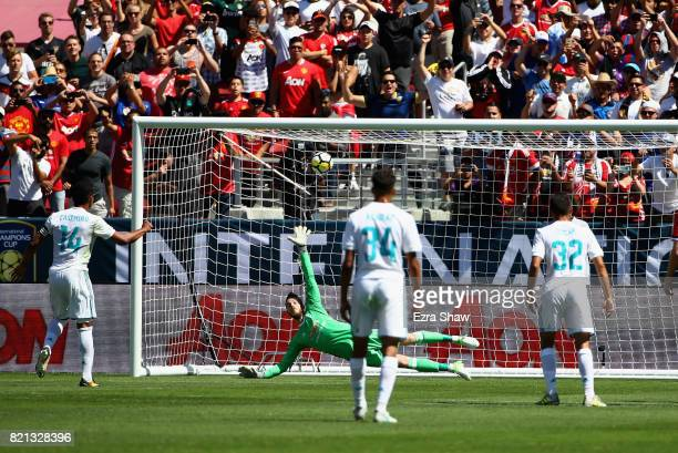 Carlos Henrique Casemiro of Real Madrid scores on a penalty kick past goalie David De Gea of Manchester United during the International Champions Cup...