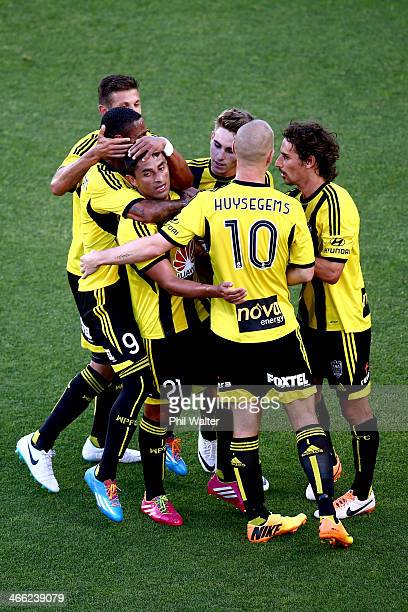 Carlos Hernandex of the Phoenix is surrounded by team mates after scoring his penalty goal during the round 17 A-League match between Wellington...