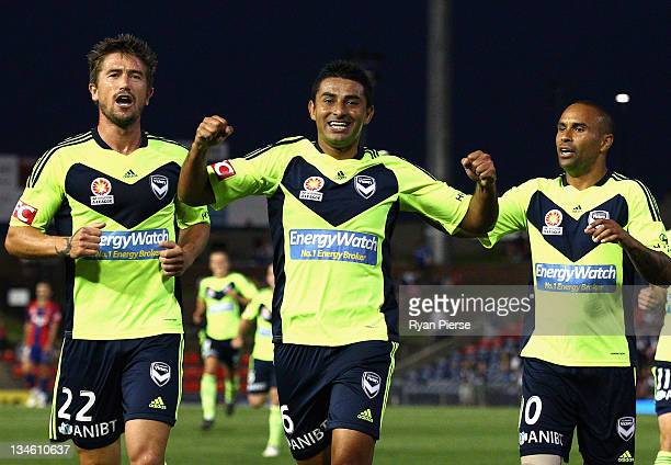 Carlos Hernandez Harry Kewell and Archie Thompson of the Victory celebrate after Hernandez scored his teams first goal during the round nine ALeague...