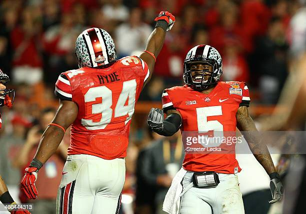 Carlos Hyde and Braxton Miller of the Ohio State Buckeyes celebrate after a touchdown by Hyde in the third quarter against the Clemson Tigers during...