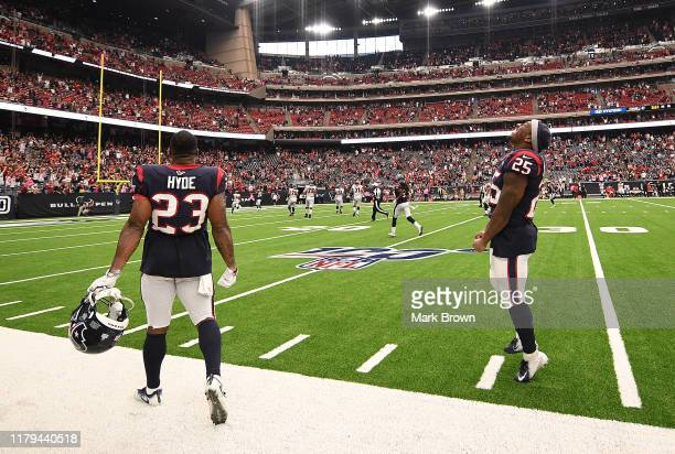 Carlos Hyde and Duke Johnson of the Houston Texans celebrate an interception returned for a touchdown by Tashaun Gipson in the foruth quarter against...