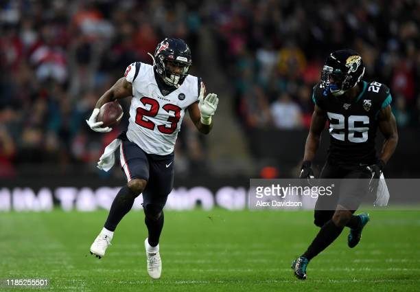 Carlos Hyde of Houston Texans gets past Jarrod Wilson of Jacksonville Jaguars during the NFL game between Houston Texans and Jacksonville Jaguars at...