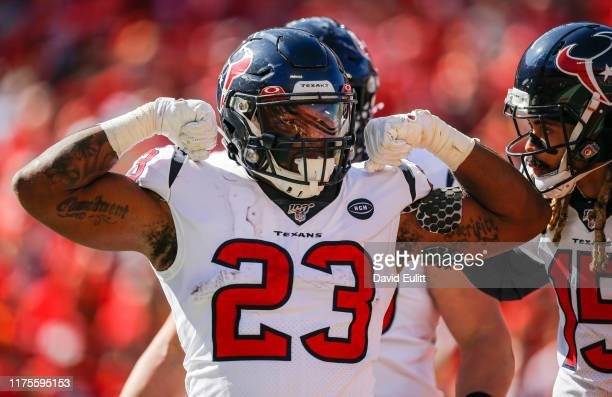Carlos Hyde of the Houston Texans celebrates his second quarter rushing touchdown against the Kansas City Chiefs at Arrowhead Stadium on October 13...