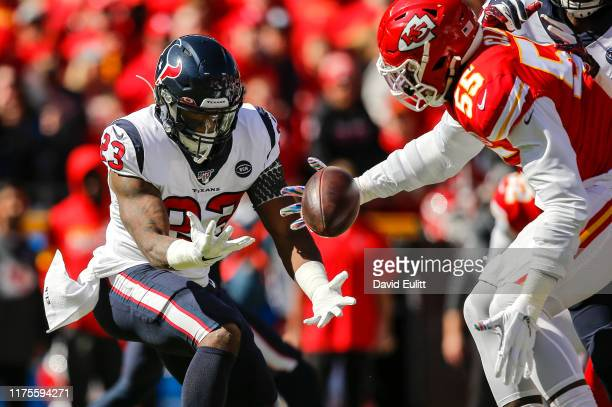Carlos Hyde of the Houston Texans fumbles the first play from scrimmage for the Texans, losing the ball to Frank Clark of the Kansas City Chiefs in...