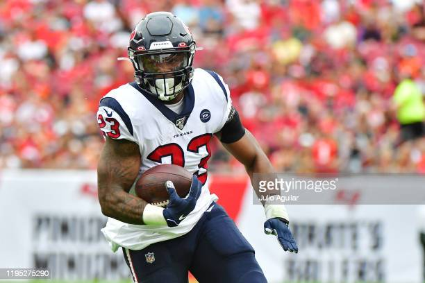 Carlos Hyde of the Houston Texans runs for a first down during the second quarter of a football game against the Tampa Bay Buccaneers at Raymond...