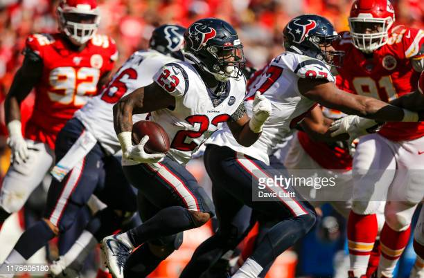 Carlos Hyde of the Houston Texans runs for a gain against the Kansas City Chiefs in the fourth quarter at Arrowhead Stadium on October 13 2019 in...