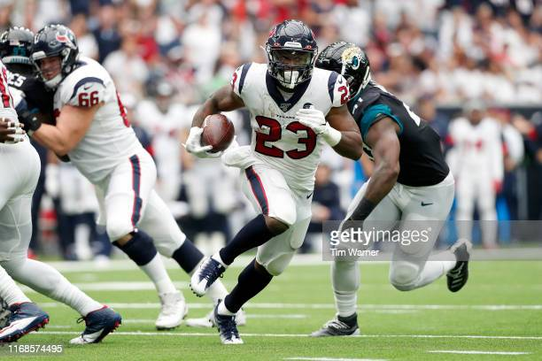 Carlos Hyde of the Houston Texans runs the ball in the second half against the Jacksonville Jaguars at NRG Stadium on September 15, 2019 in Houston,...