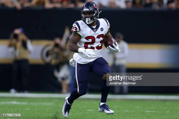 Carlos Hyde of the Houston Texans runs with the ball during a game against the New Orleans Saints at the Mercedes Benz Superdome on September 09,...