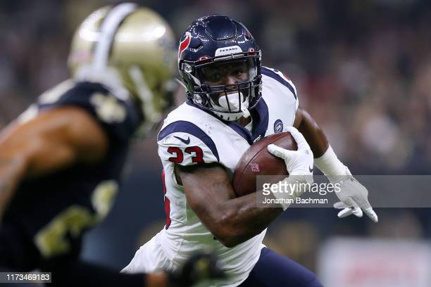 Carlos Hyde of the Houston Texans runs with the ball during the first half of a game against the New Orleans Saints at the Mercedes Benz Superdome on...