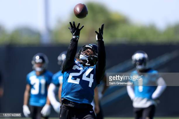 Carlos Hyde of the Jacksonville Jaguars attempts a reception during Jacksonville Jaguars Mandatory Minicamp at TIAA Bank Field on June 15, 2021 in...