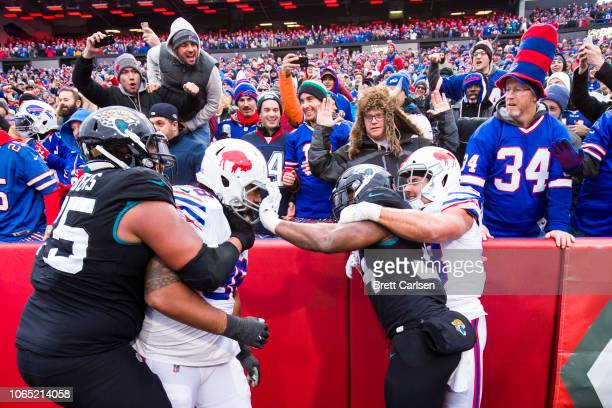 Carlos Hyde of the Jacksonville Jaguars grabs the face mask of Star Lotulelei of the Buffalo Bills as both teams scuffle during the third quarter at...