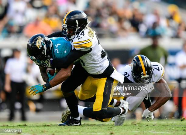 Carlos Hyde of the Jacksonville Jaguars is brought down by Sean Davis of the Pittsburgh Steelers and Coty Sensabaugh of the Pittsburgh Steelers...