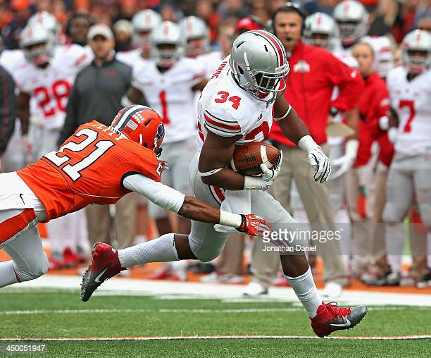 Carlos Hyde of the Ohio State Buckeyes breaks a tackle attempt by Zane Petty of the Illinois Fighting Illini to score a touchdown at Memorial Stadium...
