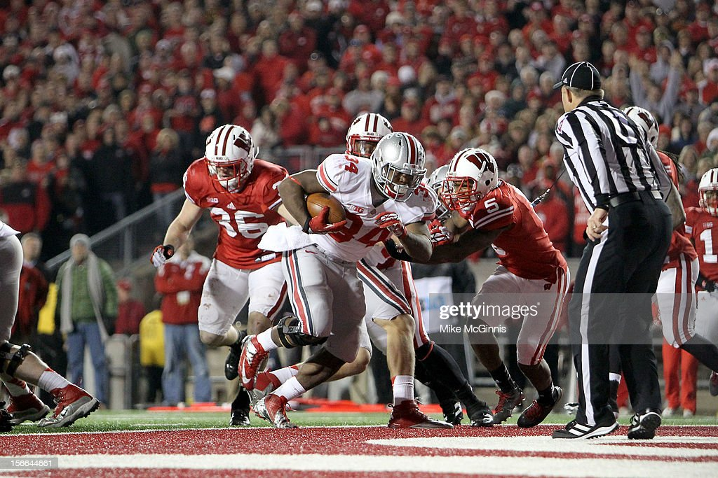Carlos Hyde #34 of the Ohio State Buckeyes runs this ball in for a touchdown in extended play during the game against the Wisconsin Badgers at Camp Randall Stadium on November 17, 2012 in Madison, Wisconsin.