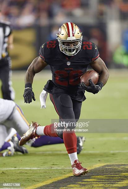 Carlos Hyde of the San Francisco 49ers carries the ball against the Minnesota Vikings during their NFL game at Levi's Stadium on September 14 2015 in...