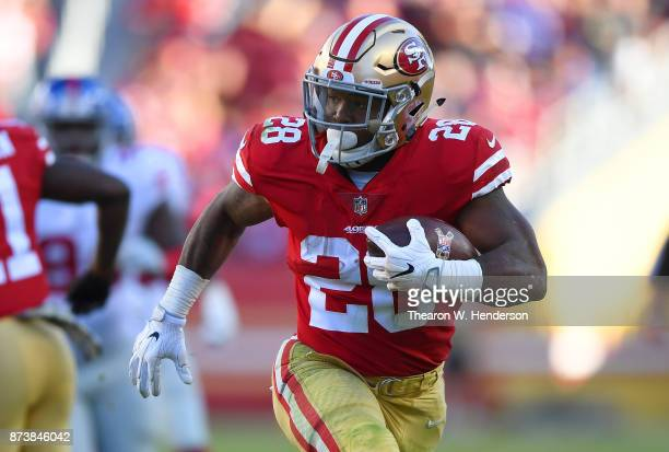 Carlos Hyde of the San Francisco 49ers carries the ball against the New York Giants during their NFL football game at Levi's Stadium on November 12...