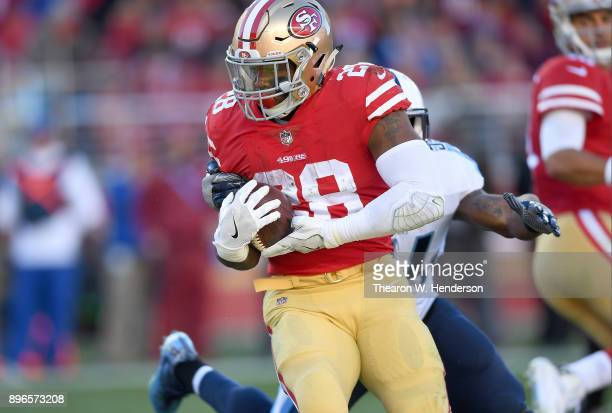 Carlos Hyde of the San Francisco 49ers carries the ball against the Tennessee Titans during their NFL football game at Levi's Stadium on December 17...
