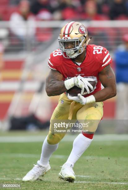 Carlos Hyde of the San Francisco 49ers carries the ball against the Jacksonville Jaguars during their NFL football game at Levi's Stadium on December...