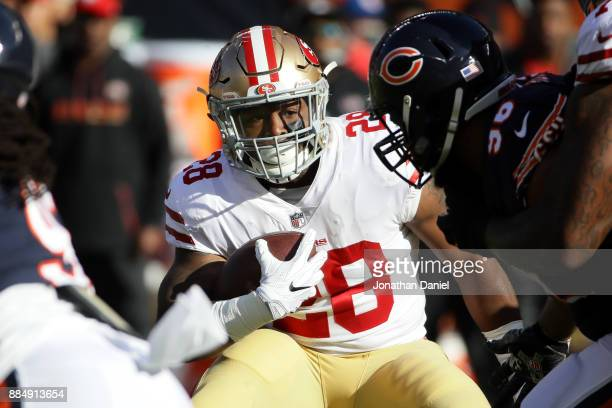 Carlos Hyde of the San Francisco 49ers carries the football in the first quarter against the Chicago Bears at Soldier Field on December 3 2017 in...