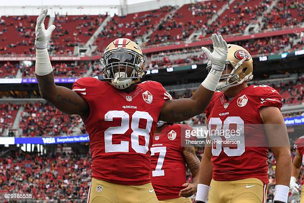 Carlos Hyde of the San Francisco 49ers celebrates after scoring against the New York Jets in the first quarter of their NFL game at Levi's Stadium on...