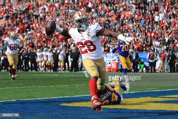 Carlos Hyde of the San Francisco 49ers celebrates scoring a touchdown during the first quarter against the Los Angeles Rams at Los Angeles Memorial...