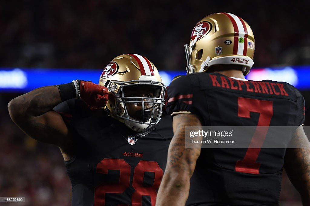 Carlos Hyde #28 of the San Francisco 49ers celebrates with Colin Kaepernick #7 after scoring in the second quarter of their NFL game against the Minnesota Vikings at Levi's Stadium on September 14, 2015 in Santa Clara, California.