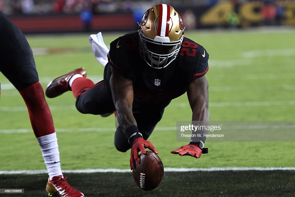 Carlos Hyde #28 of the San Francisco 49ers dives for a touchdown against the Minnesota Vikings in the second quarter of their NFL game at Levi's Stadium on September 14, 2015 in Santa Clara, California.
