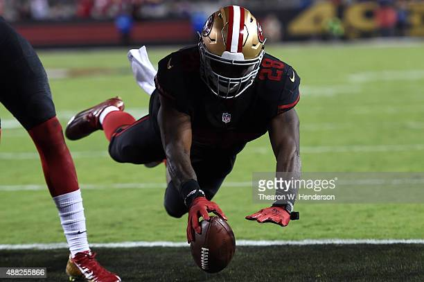Carlos Hyde of the San Francisco 49ers dives for a touchdown against the Minnesota Vikings in the second quarter of their NFL game at Levi's Stadium...