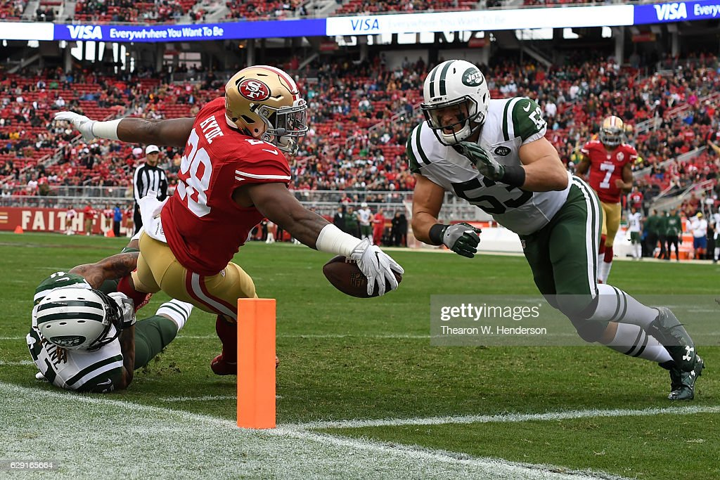 Carlos Hyde #28 of the San Francisco 49ers dives for a touchdown against the New York Jets in the first quarter of their NFL game at Levi's Stadium on December 11, 2016 in Santa Clara, California.
